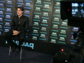 Tennis star Roger Federer gives an interview at the NASDAQ MarketSite on Aug. 25, 2005.