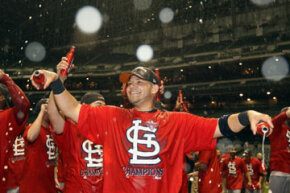 Yadier Molina of the St. Louis Cardinals celebrates winning the National League Championship Series against the Milwaukee Brewers in October 2011.