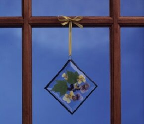 Make a sparkling stained glass ornament.
