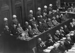 The 21 defendants on trial at Nuremberg await their verdicts. Eighteen were found guilty, 11 of those were hanged. See more pictures of men of war.