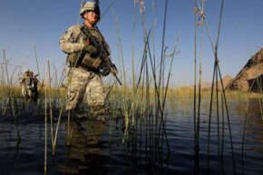 A lieutenant in the U.S. Army steps carefully to avoid bombs outside Kandahar, Afghanistan. Doing a job this delicate requires extensive training, mostly in the form of professional development courses provided by the Army.