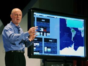 Intel Executive Vice President Sean Maloney demonstrates the power of the Nehalem microarchitecture using a touchscreen interface at a press conference.