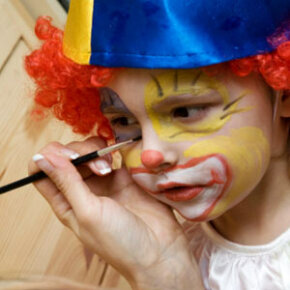 There are tons of fun things you can do with the kids, like set up a face painting station run by the neighborhood's teenagers.
