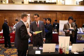 A job seeker chats with a recruiter at a job fair in San Francisco. What can you do to make networking less painful?
