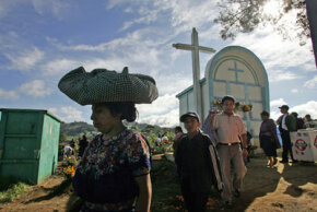 People visit the tombs of their relatives during All Saints' Day celebrations.