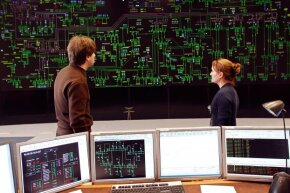 Technicians monitoring electricity consumption on a power grid in France.