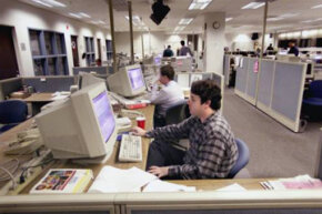 Reporters hard at work in the newsroom at The Herald-Sun