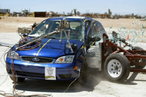 This National Highway Transportation Safety Administration photo shows a side-impact crash test of a 2005 Ford Focus.