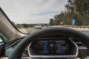View through the windshield of the 2013 Tesla Model S as the Google self-driving car motors along the San Francisco freeway.