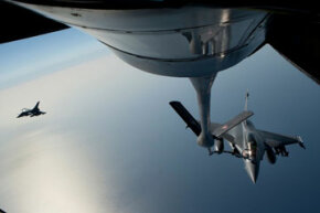 "A French air force fighter jet refuels with a Boeing refueling tanker over the Mediterranean sea during the no-fly zone operation ""Harmattan"" in the critical region on Benghazi, in April 2011."