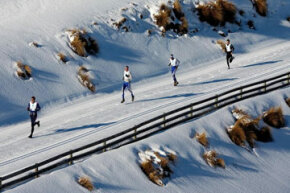 Winter triathletes trudge through the snow during the winter triathlon at the 2009 Winter Games NZ in Wanaka, New Zealand.