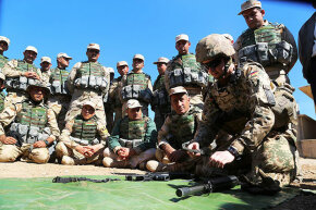 Coalition forces (including U.S. military) train Iraq's Kurdish Peshmergas. Regardless of personal feelings, U.S. military personnel are not allowed to denigrate the president or Congress.