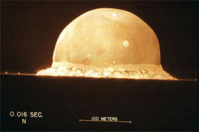 A photograph shows the first atomic bomb test on July 16, 1945, at 5:30 a.m., at the Trinity Site in New Mexico.