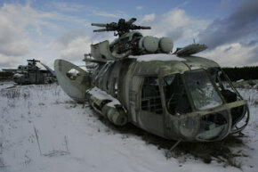 Highly radiated helicopters used to dump concrete and water on the Chernobyl reactor in 1986 lay in a field near the Ukrainian village of Rosoha.