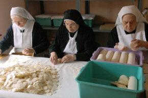 Polish nuns prepare communion hosts for a service.