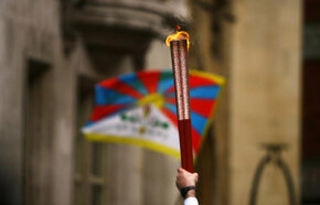 The Tibetan flag flies as the 2008 Beijing Olympics torch is carried by respected sports personalities and celebrities from Wembley Stadium to the grand finale at the O2 Dome, April 6, 2008 in London, England. See more Olympics pictures.