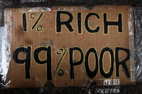 "Occupy Wall Street protests on behalf of the ""99 percent."" See more protesting pictures."