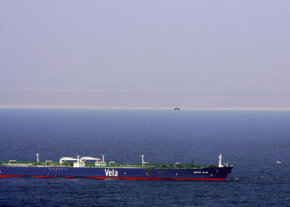 A parachute floats down to hijacked oil tanker MV Sirius Star, nearly two months after it was attacked by pirates off the coast of Kenya.