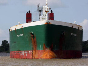 An oil tanker rides through Plaquemines Parish, Louisiana in 2008. Oil production suffered in the wake of Hurricanes Katrina and Rita in 2005.