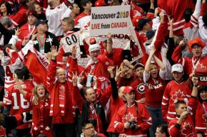 Canada fans cheer on their team during the ice hockey men's gold medal game in Vancouver between the USA and Canada -- which Canada won.