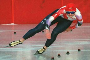 United States speed skater Bonnie Blair glides around a curve during the women's 1000 meters at the Albertville Olympics on her way to a gold medal.