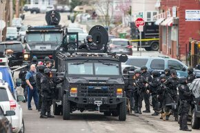 SWAT teams move into position in Massachusetts while searching for a marathon bombing suspect. Phoning in a fake 9-1-1 call about a serious crime can result in a SWAT team descending on an unsuspecting target, a dangerous practice called swatting.