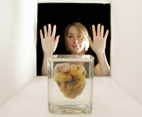 Heart transplant patient Jennifer Sutton admires her old heart at the Wellcome Collection's Heart Exhibition in London. She donated her heart to promote awareness about organ donation and restrictive cardiomyopathy -- a disease that nearly killed her.
