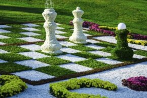 Instead of concrete, this beautifully landscaped outdoor chessboard opts for pebbles, but it doesn't look like those pieces are too mobile.
