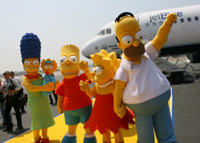 Many U.S. cartoon shows such as The Simpsons, shown here at their big-screen debut, are finished by overseas animators.