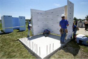Workers in Sioux City, Iowa, construct a tornado shelter with cement-filled foam walls.