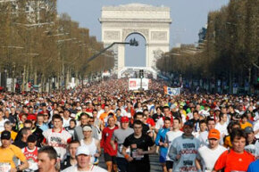 Competitors take part in the 34th Paris marathon as they run down the Champs Elysees, Sunday, April 11, 2010. Ethiopian Tadesse Tola won the race.