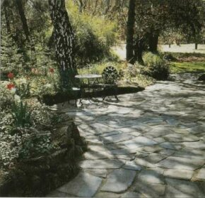 The synthetic rock edging the area is more economical to buy and install than natural stone.