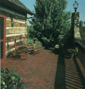 Brick-look quarry tiles laid in a herringbone pattern add dimension and visual interest to terrace edging.