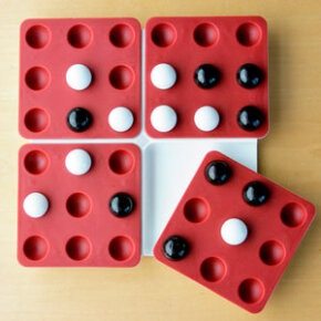 For the travel edition pictured here, the board's quadrants are attached to the base by sliding, swiveling mechanisms.The spatial reasoning required to plan ahead for quadrant twists will challenge children and adults alike.