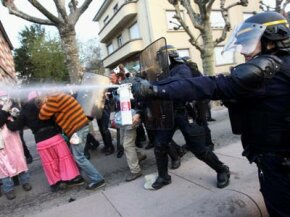 A French riot policeman uses pepper spray against protestors during the NATO summit on April 4, 2009, in Strasbourg, France. See more police pictures.