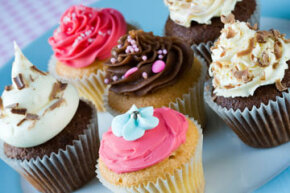 The promise of delicious treats isn't the only reason cupcakes make you happy. The vanilla you smell in baked goods can be a mood booster.
