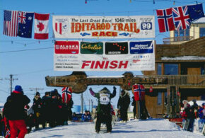 Harold Tunheim and his team of dogs cross the finish line for the Iditarod Trail Race in Nome, Alaska, in 1999. See more Iditarod pictures.