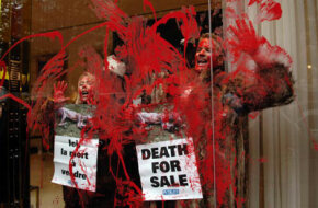 People for the Ethical Treatment of Animals activists protest in the shop of French designer Jean-Paul Gaultier. The animal rights group stages protests against stores, restaurants and events all over the world.