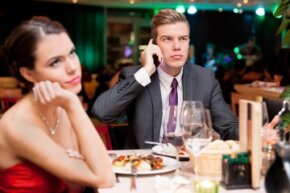 Answering your cellphone at the dinner table is often seen as rude or inconsiderate, but it turns out many people do it nowadays. Is it slowly becoming more acceptable?