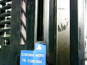 The corona wire uses static electricity to coat both the photoreceptive drum and the copy paper with a layer of positively charged ions.