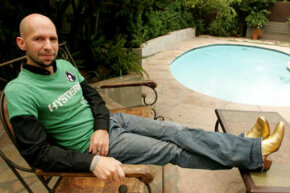 """Neil Strauss, """"The Game"""" author and pickup artist master, relaxes in his gold cowboy boots."""