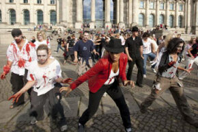 People participate in a zombie/Michael Jackson tribute flash mob in front of the Reichstag on August 29, 2009 in Berlin, Germany.