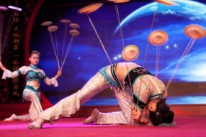 Acrobats performing a plate-spinning routine at Laoshe teahouse in Beijing in 2012