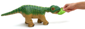 Pleo plays with a training leaf. In a future Pleo version, people may be able to use the training leaf to teach Pleo tricks.