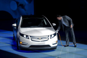 A staff member of GM China charges up a Chevrolet Volt during a ceremony to send a pair of Volts to Shanghai Expo Bureau in Shanghai, China. See more pictures of plug-in hybrid cars.