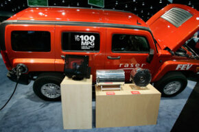 This plug-in electric Hummer H3 has a range of about 400 miles, driving its first 40 miles on batteries before turning on its combustion generator.