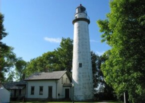 The white conical lighthouse at Point Aux Barques is among the most photographed lighthouses in the Great Lakes region. See more lighthouse pictures.