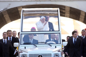 Pope Benedict XVI waves to the faithful as he arrives in St. Peter's Square for his final general audience on Feb. 27, 2013 in Vatican City, Vatican.