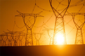 A network of electricity pylons in central Xinjiang, China, is silhouetted against the setting sun. See images of nuclear power.