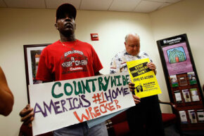 Marcus West and Larry Heard take part in a protest by ACORN at Countrywide home loans center in October 2007. The nonprofit organization accused Countrywide of predatory lending practices.